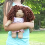 Our soft Camden Dolls are hand-sewn with simple features to allow for the full range of expression in a child's imagination. Boy and girl dolls come with different hair colors and skin tones.