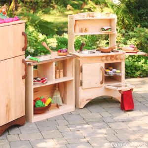 This beautiful wood kitchen includes a fridge and shelves handcrafted in the USA for the natural, non-toxic playroom.